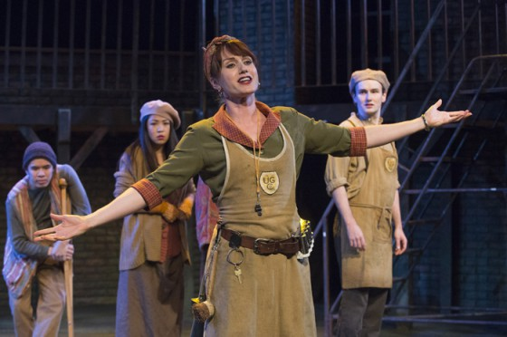 Meghan Gardiner in Urinetown: The Musical. Behind her: Chris Lam, Rosie Simon, Anton Lipovetsky. Image David Cooper.